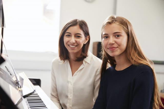 Piano lesson with female teacher and female student