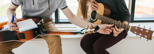 Guitar lesson with notepad