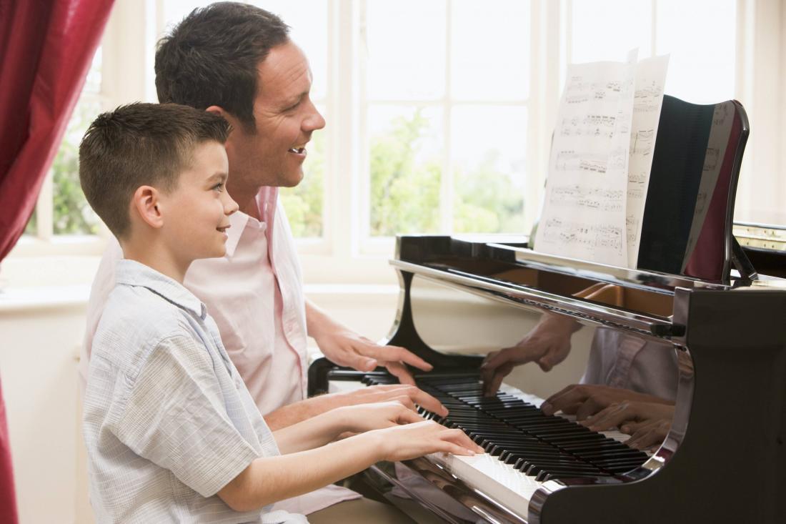 man and boy at piano