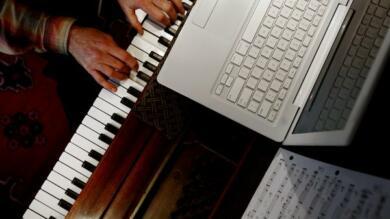 Piano at computer