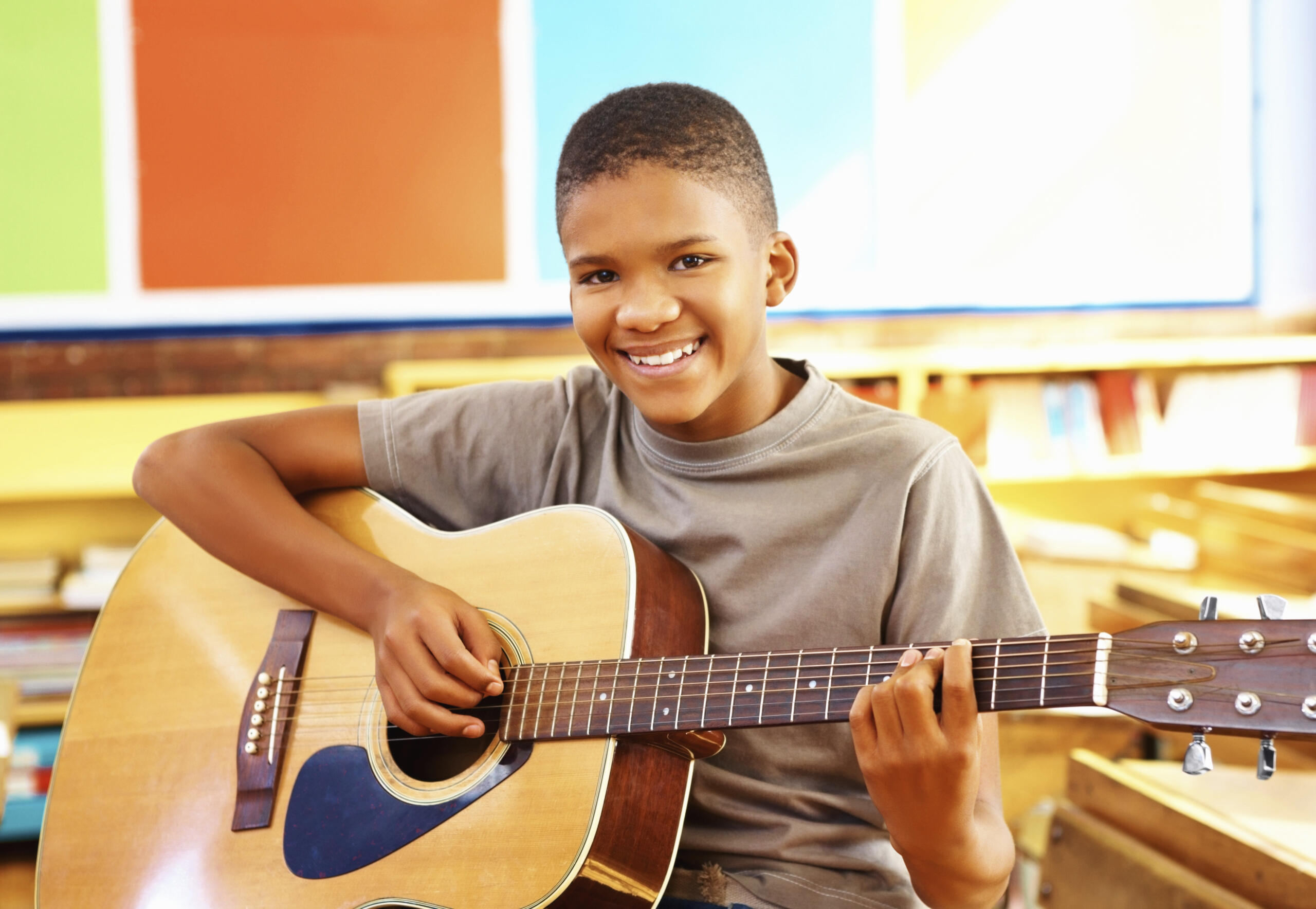 boy learning to play guitar
