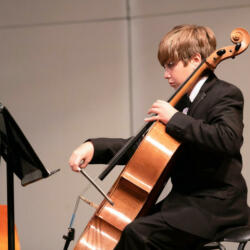 Young boy playing the cello