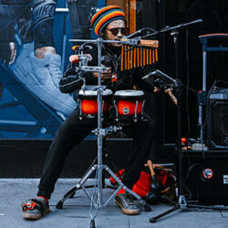 Street performer with fusion drums set